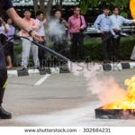 stock-photo-instructor-showing-how-to-use-a-fire-extinguisher-on-a-training-fire-302684231